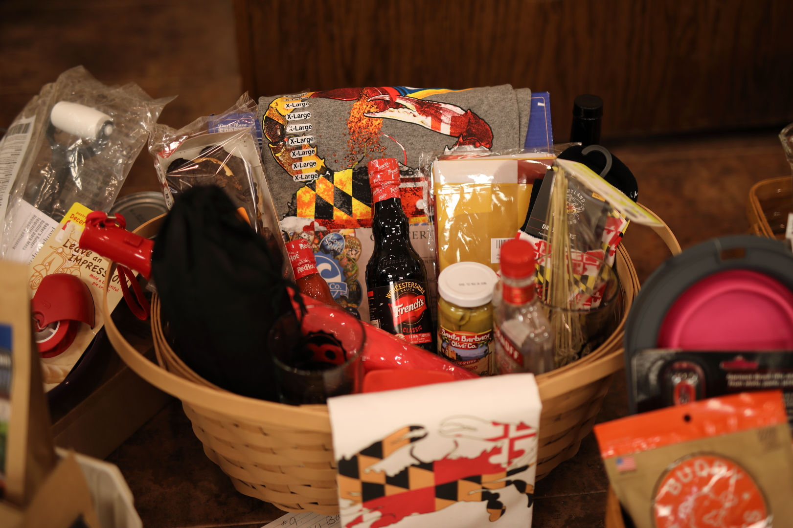 Maryland Longaberger basket with products from Maryland: cookies, mustard, seasoning, etc.