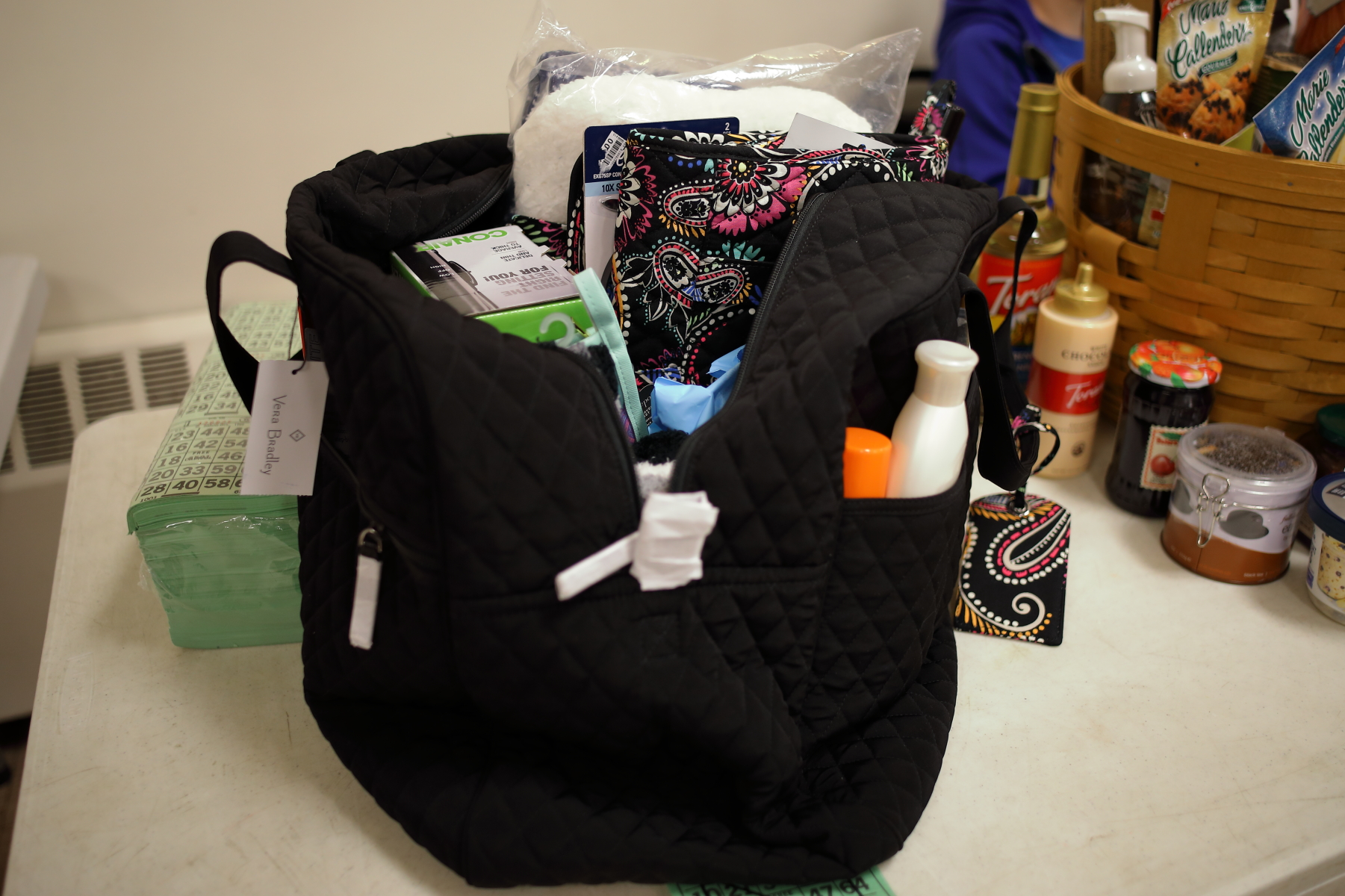 Vera Bradley solid black bag with travel necessities.